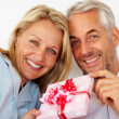 Royalty-Free Stock Photo: Romantic senior couple holding a gift