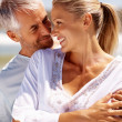 Closeup of a couple on a sunny day at the beach - Stock Photo