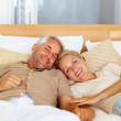 Royalty-Free Stock Photo: Charming mature couple sleeping on the bed
