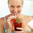 Beautiful woman enjoying a drink in the pool - Stock Photo