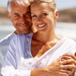 Senior couple on a sunny day at the beach - Stock Photo
