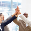 Cheerful business team with their hands raised together - Stock Photo