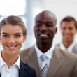 Royalty-Free Stock Photo: Happy business woman with her colleagues at the back