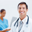 Royalty-Free Stock Photo: Happy doctor with his nurse at the back