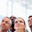 Royalty-Free Stock Photo: Group of business colleagues looking upwards at copyspace