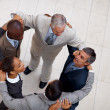 Royalty-Free Stock Photo: Top view of a team of business colleagues together in a circle
