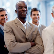 Royalty-Free Stock Photo: An image of a delighted African American business man smiling co
