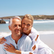 Mature couple enjoying a sunny day at the beach - Stock Photo