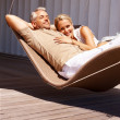 Portrait of an aged couple relaxing in hammock - Stok fotoğraf