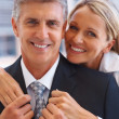 Happy modern couple dressed to impress - Stock Photo
