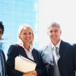 Royalty-Free Stock Photo: Four business colleagues smiling in a line