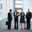 Royalty-Free Stock Photo: Group of business colleagues at a hallway