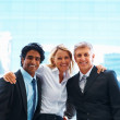 Happy group of confident business colleagues - Stock Photo