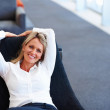 A charming pretty business woman relaxing - Stock Photo