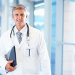 Royalty-Free Stock Photo: A confident mature doctor, smiling