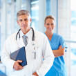 Royalty-Free Stock Photo: Two successful doctors standing together