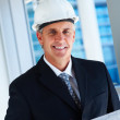 Royalty-Free Stock Photo: A handsome builder in black suit, smiling