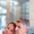 Happy mature business couple day dreaming - Stok fotoğraf
