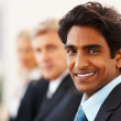 Royalty-Free Stock Photo: Business man smiling with colleagues behind him
