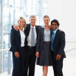 Royalty-Free Stock Photo: Happy business colleagues standing at a hallway