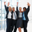 Royalty-Free Stock Photo: Victorious team of business at the hallway