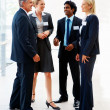 Royalty-Free Stock Photo: Full length of business associates having a discussion