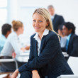 Young beautiful business executive smiling while sitting in the - Stock Photo