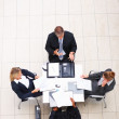 Top view of sophisticated business working in the office - Stock Photo