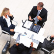 Top view: Sophisticated business sitting in a meeting - Stock Photo