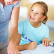 Royalty-Free Stock Photo: Mom is helping her daughter with homework