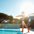 Happy boy plunging into the swimming pool - Foto Stock