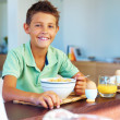 Royalty-Free Stock Photo: Young boy having a healthy breakfast at home