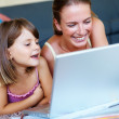 Royalty-Free Stock Photo: Mother and daughter enjoying while working on laptop