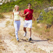 Royalty-Free Stock Photo: Healthy fit couple actively running outdoors