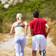 Royalty-Free Stock Photo: Athletic couple staying fit by jogging