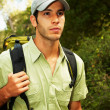Young man ready to go hiking in the nature - Photo