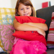 Royalty-Free Stock Photo: Portrait of a innocent young girl holding a pillow