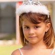 Royalty-Free Stock Photo: Closeup portrait of a sweet little girl wearing a crown