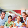 Parents helping their children with their schoolwork - Stock Photo