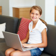 Royalty-Free Stock Photo: Lovely young girl learning to use a laptop