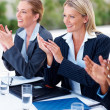 Royalty-Free Stock Photo: Business women clapping their hands during a meeting
