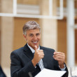 Royalty-Free Stock Photo: Successful senior business man showing a thumbs up