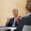 Royalty-Free Stock Photo: Mature business man enjoying a meeting with colleagues