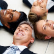 Royalty-Free Stock Photo: Cheerful group of business lying on the floor