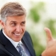 Royalty-Free Stock Photo: Closeup of a senior handsome business man with his thumb up