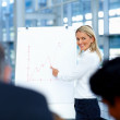 Royalty-Free Stock Photo: Young businesswoman doing a presentation
