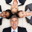 Royalty-Free Stock Photo: Successful group of business lying on the floor
