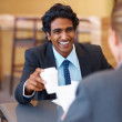 Young Asian business man in the canteen with a colleague - Stock Photo