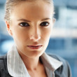 Closeup of a pretty business woman, serious look - Foto de Stock