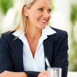 Royalty-Free Stock Photo: Successful gorgeous business woman smiling at a meeting
